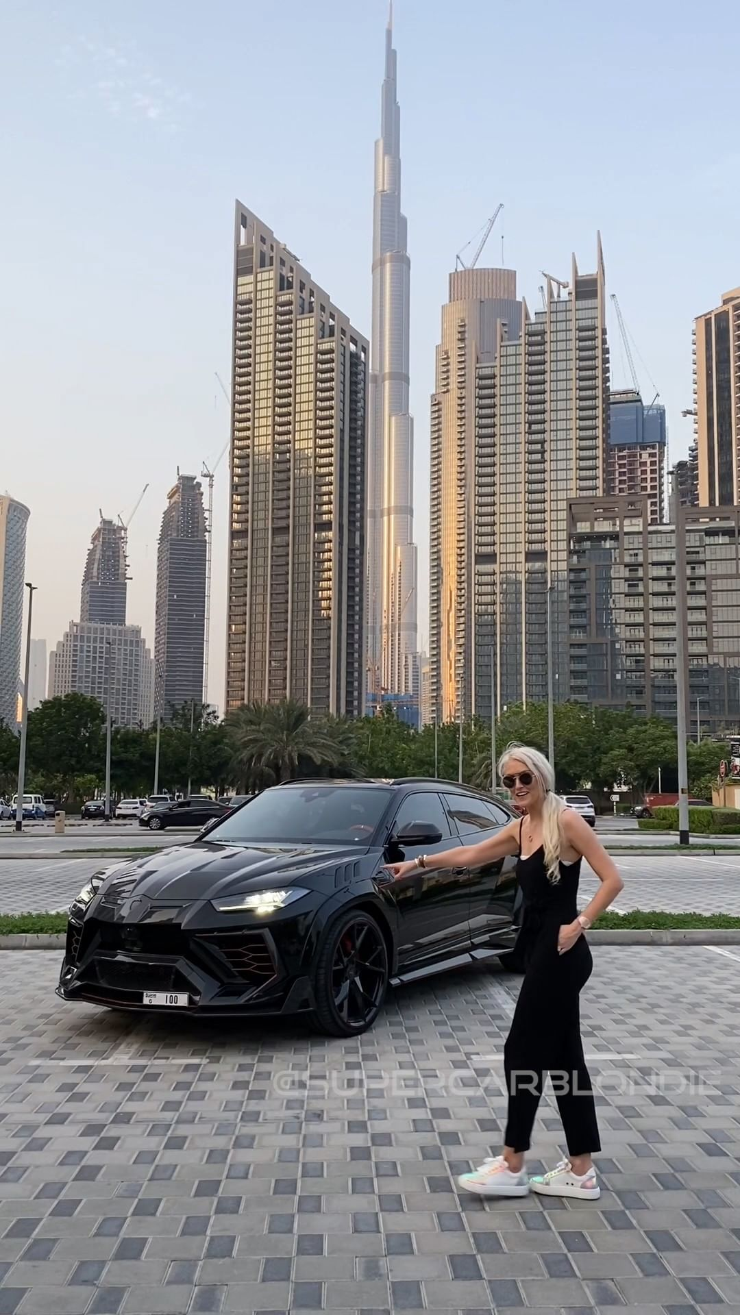 This is a custom Lamborghini Urus done by Mansory and costs double wha – Alexandra Mary – supercar blondie 📰